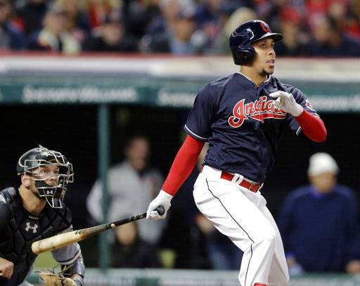 Cleveland Indians' Michael Brantley watches his single off Chicago White Sox starting pitcher Carson Fulmer in the fifth inning of a baseball game, Saturday, Sept. 30, 2017, in Cleveland. White Sox catcher Kevan Smith also watches.