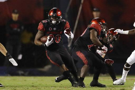 San Diego State running back Rashaad Penny runs with the ball during the first half of an NCAA college football game against Northern Illinois, Saturday, Sept. 30, 2017, in San Diego.