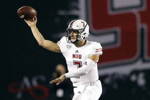 Northern Illinois quarterback Daniel Santacaterina throws a pass during the first half of an NCAA college football game against San Diego State, Saturday, Sept. 30, 2017, in San Diego.