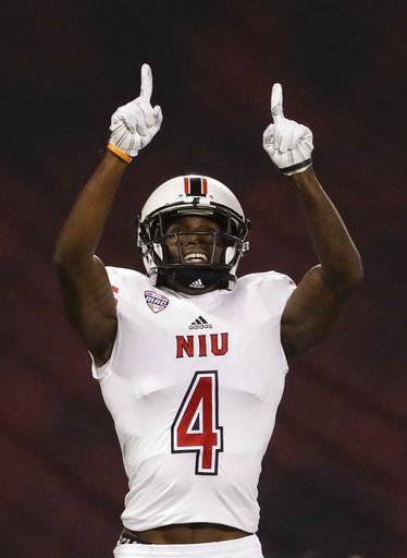 Northern Illinois wide receiver Christian Blake reacts after scoring a touchdown during the first half of an NCAA college football game against San Diego State, Saturday, Sept. 30, 2017, in San Diego.