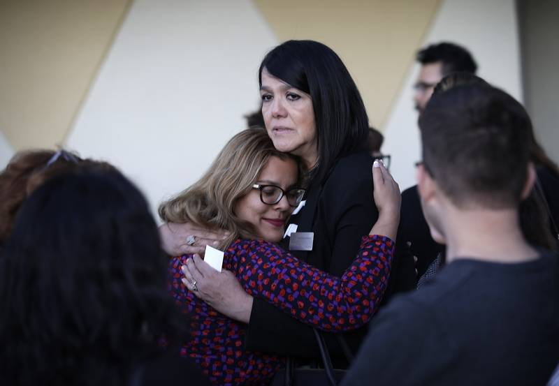 Maritza Rodriguez, right, embraces Emily Zamora after a special service at  Guardian Angel Cathedral