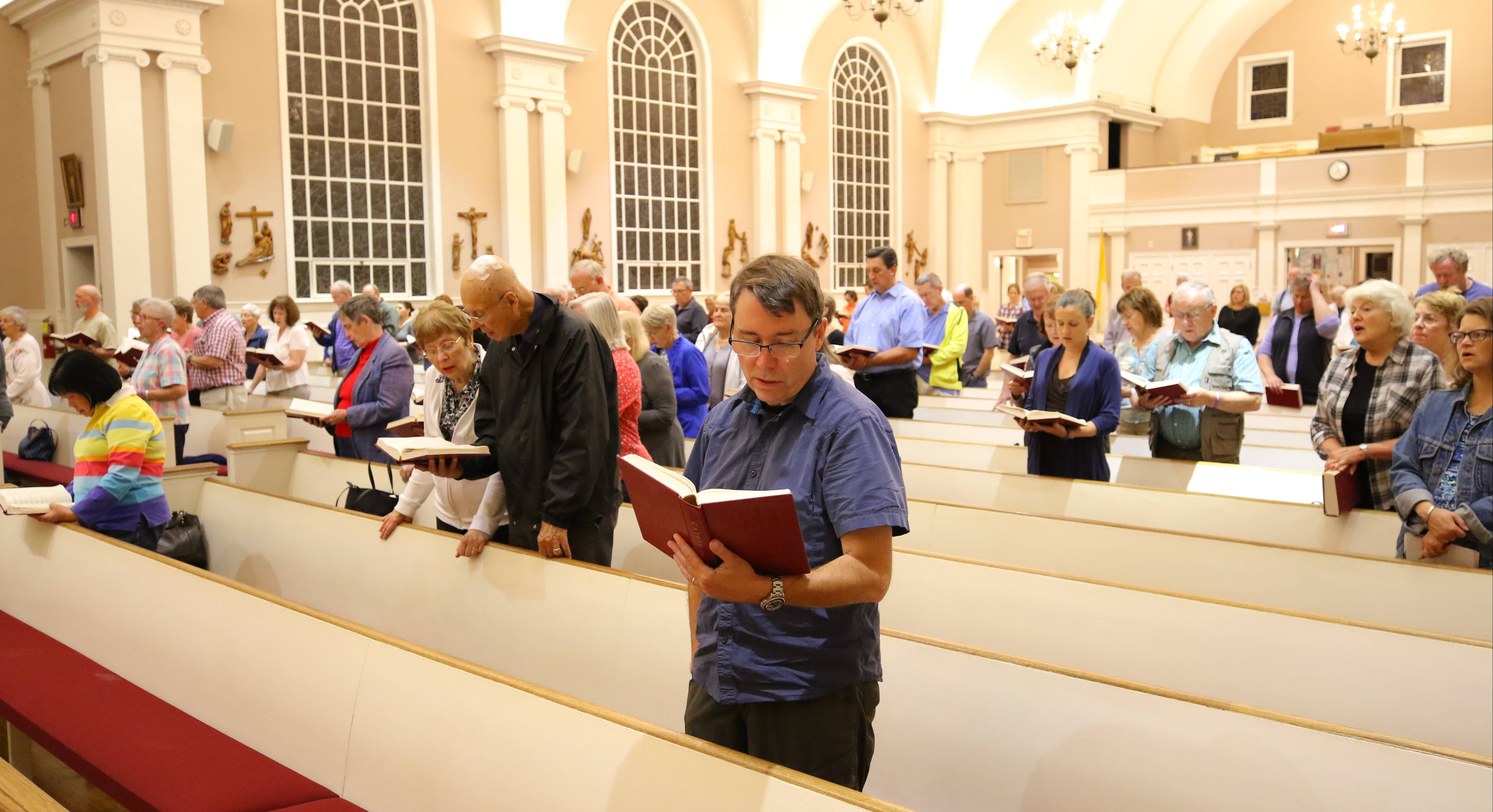 Parishioners attend a prayer service for the Las Vegas shooting victims Monday evening at St. James Catholic Church in Arlington Heights.