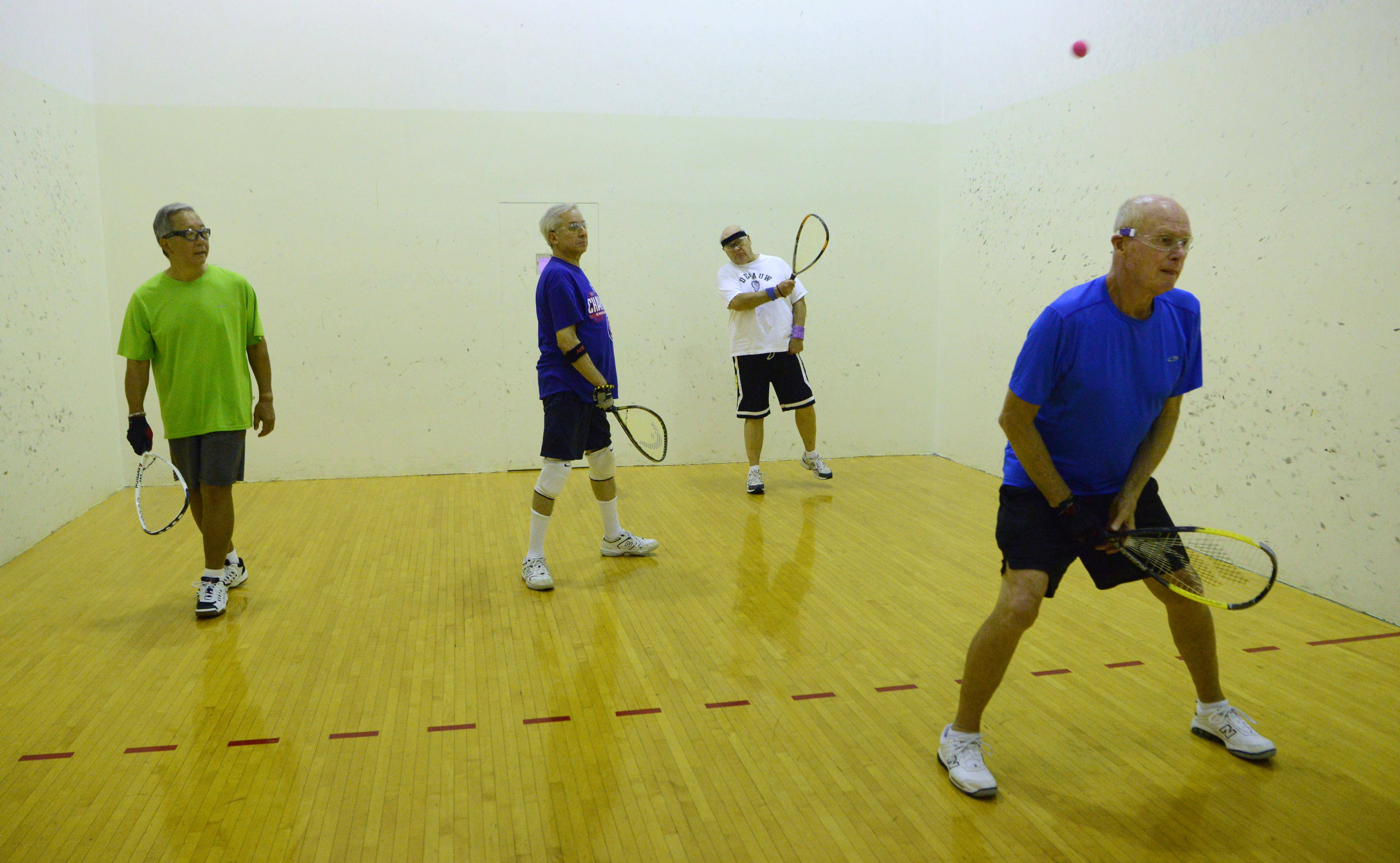 From left, George Shibayana of Arlington Heights, Rich Tepperman of Schaumburg, Len Hochmuth of Mount Prospect and Steve Pierce of South Barrington play racquetball at the Forest View Racquet and Fitness Club in Arlington Heights.