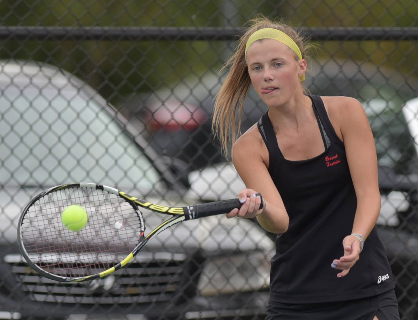 Benet's Caroline Arnold competes against York's Isabella Nicoli during varsity girls tennis in Lisle on October 2, 2017.