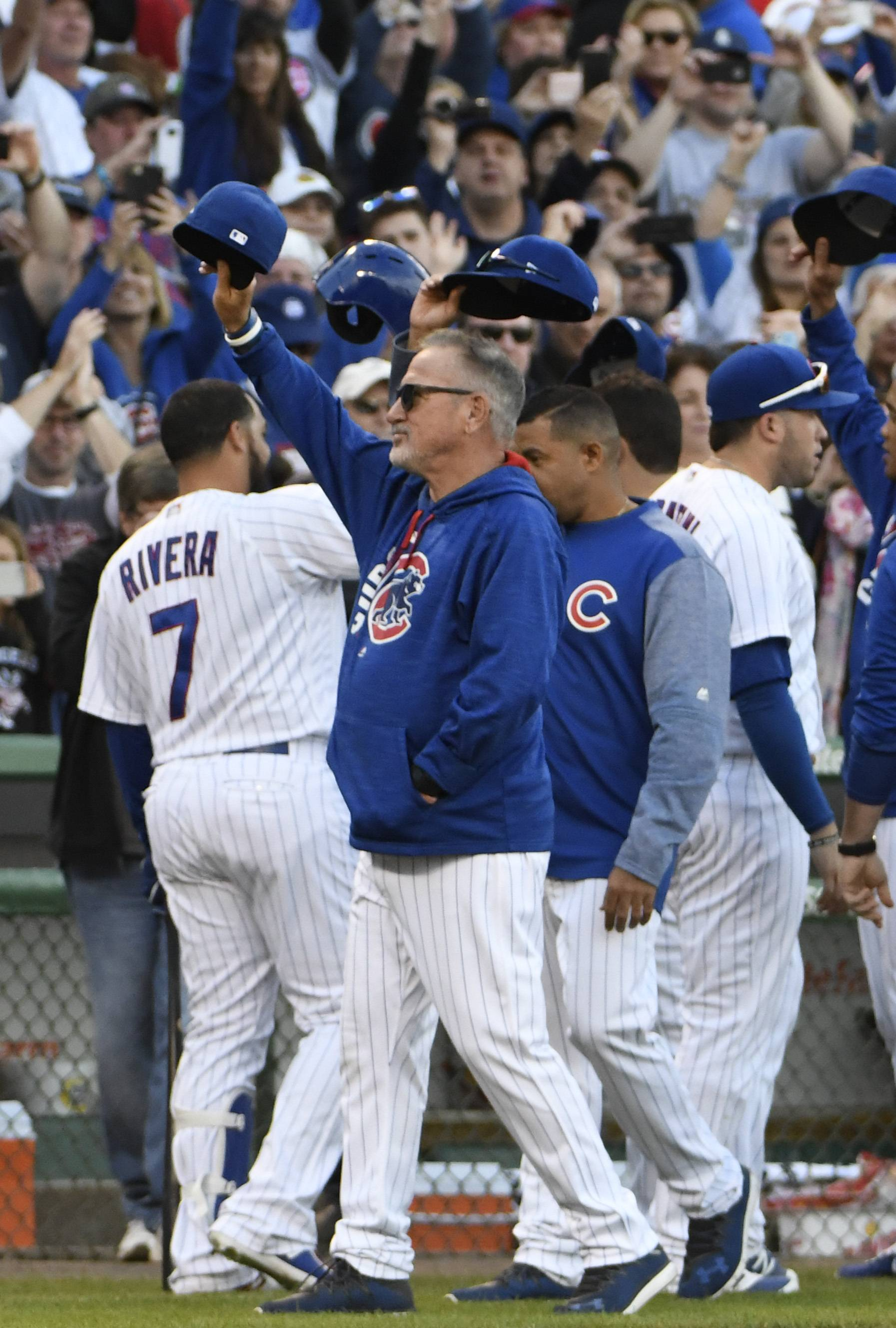 Chicago Cubs manager Joe Maddon, center, acknowledges the fans after the last regular season baseball game against the Cincinnati Reds, Sunday, Oct. 1, 2017, in Chicago. The Reds defeated the Cubs 3-1.