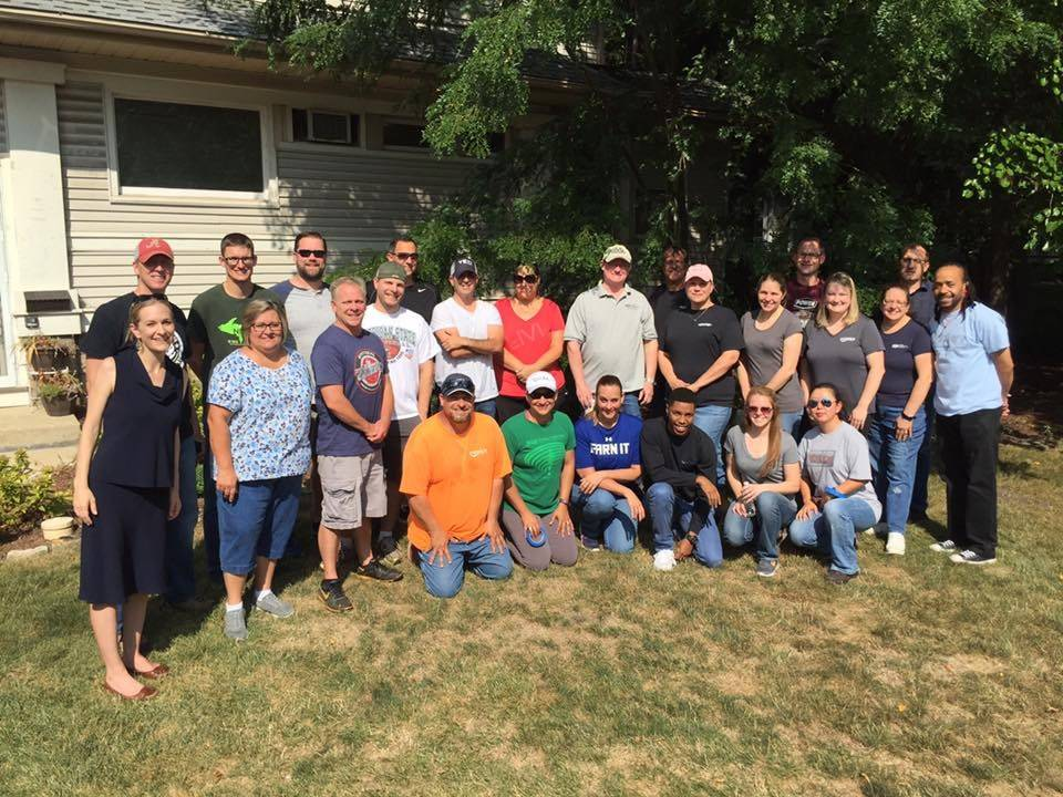 Twenty-three employees from Power Construction Company, LLC of Chicago clean and make improvements to a ChildServ group home for teenage girls in Downers Grove.