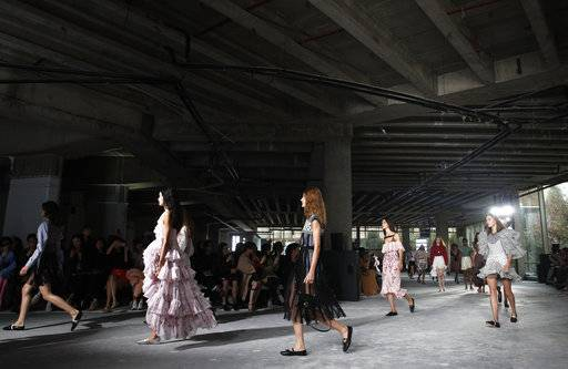 Models wear creations for Giambattista Valli Spring-Summer 2018 ready-to-wear fashion collection presented Monday, Oct. 2, 2017 in Paris.