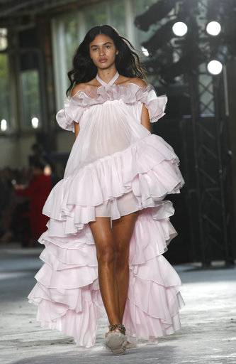 A model wears a creation for Giambattista Valli Spring-Summer 2018 ready-to-wear fashion collection presented Monday, Oct. 2, 2017 in Paris.