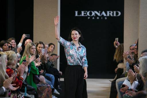 Designer Christine Phung acknowledges applause after Leonard Spring-Summer 2018 ready-to-wear fashion collection presented Monday, Oct. 2, 2017 in Paris.