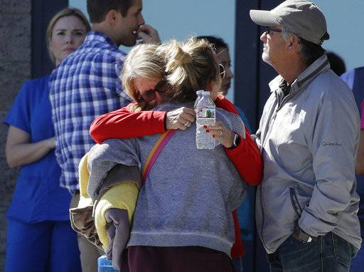 Two women embrace outside of a family assistance center Monday, Oct. 2, 2017, in Las Vegas. The makeshift center was set up to help families and others reconnect after the mass shooting on the Las Vegas Strip.