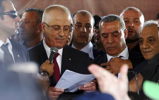 Palestinian Prime Minister Rami Hamdallah, speaks during a press conference on his arrival to the Palestinian side of the Beit Hanoun border crossing in the northern Gaza Strip, Monday, Oct. 2, 2017. Hamdallah is in Gaza for the most ambitious attempt yet to end the 10-year rift between rival Palestinian factions Fatah and Hamas.