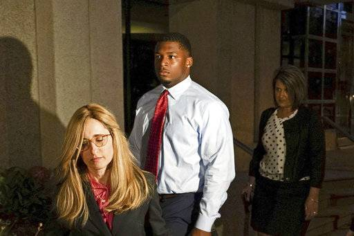 "FILE â€"" In this Sept. 14, 2017 file photo, Ma'lik Richmond, center, of Steubenville, Ohio, and his attorney Susan Stone, left, walk out of U.S. District Court in Youngstown, Ohio. In a deal announced Monday, Oct. 2, 2017, Youngstown State University has agreed to settle a federal lawsuit with Richmond, a football player convicted of rape as a teen who sued after the school allowed him to join the team and then told him he couldn't play this season."