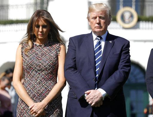 President Donald Trump and first lady Melania Trump stand during a moment of silence to remember the victims of the mass shooting in Las Vegas, on the South Lawn of the White House in Washington, Monday, Oct. 2, 2017.