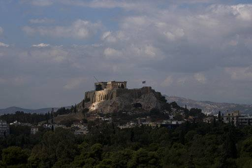 The sun shines on the ancient Acropolis hill, with the ruins from the fifth century BC in Athens, Monday, Oct. 2, 2017.