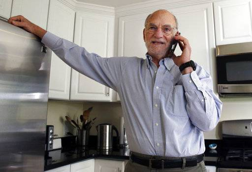 Michael Rosbash takes a phone call at his home, Monday, Oct. 2, 2017, in Newton, Mass. Rosbach is one of the Americans awarded this year's Nobel Prize in physiology or medicine for discovering the molecular mechanisms that control humans' circadian rhythm.