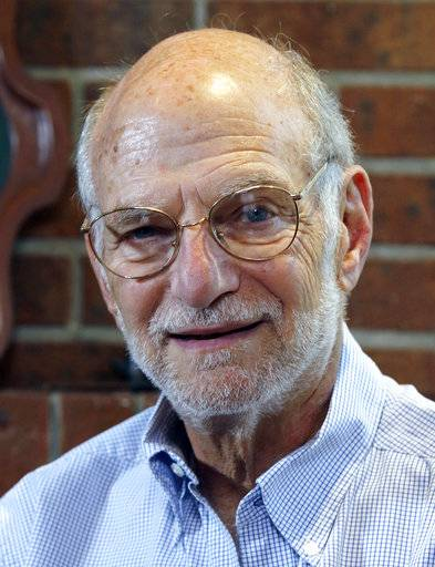 Michael Rosbash smiles during an interview at his home, Monday, Oct. 2, 2017, in Newton, Mass. Rosbach is one of the Americans awarded this year's Nobel Prize in physiology or medicine for discovering the molecular mechanisms that control humans' circadian rhythm.
