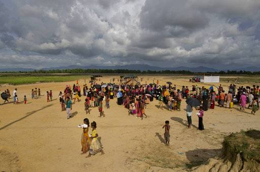 Newly arrived Rohingya Muslim from Myanmar gather in an open space to receive rations in Jadipara, Bangladesh, Monday, Oct. 02, 2017.
