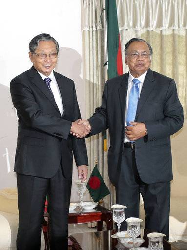 Myanmar' Foreign Minister Kyaw Tin, left, shakes hands with his Bangladeshi counterpart Abul Hassan Mahmud Ali before their meeting in Dhaka, Bangladesh, Monday, Oct. 2, 2017. Myanmar authorities have taken foreign diplomats and United Nations representatives on a tour of conflict-torn northern Rakhine state, where a security crackdown has led to an exodus of a half-million Rohingya Muslims.