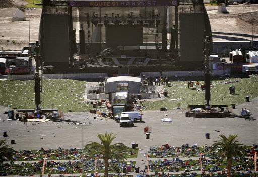 Debris is strewn through the scene of a mass shooting at a music festival near the Mandalay Bay resort and casino on the Las Vegas Strip, Monday, Oct. 2, 2017, in Las Vegas.