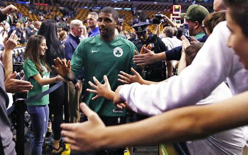 Boston Celtics guard Kyrie Irving is greeted by fans after the teams NBA preseason basketball game against the Charlotte Hornets in Boston, Monday, Oct. 2, 2017. The Celtics defeated the Hornets 94-82.