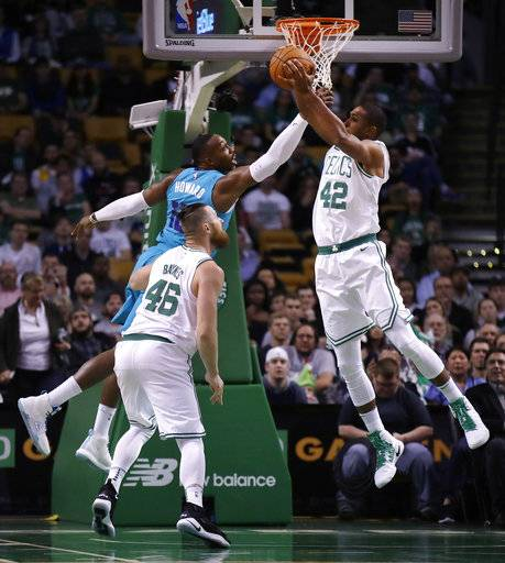 Boston Celtics center Al Horford (42) grabs a rebound next to Charlotte Hornets center Dwight Howard during the first quarter of an NBA preseason basketball game in Boston, Monday, Oct. 2, 2017.