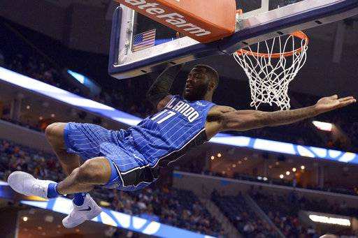 Orlando Magic guard Jonathon Simmons slips off the rim after a dunk during the first half of an NBA basketball preseason game against the Memphis Grizzlies on Monday, Oct. 2, 2017, in Memphis, Tenn.