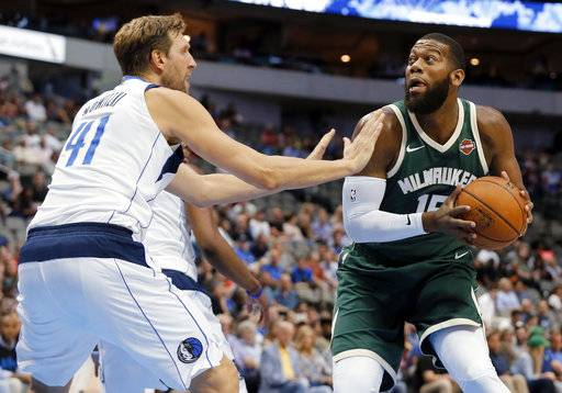 Dallas Mavericks forward Dirk Nowitzki (41) defends as Milwaukee Bucks center Greg Monroe (15) works to the basket during the first half of a preseason NBA basketball game, Monday, Oct. 2, 2017, in Dallas.