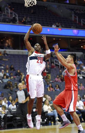 Washington Wizards guard Jodie Meeks (20) goes to the basket against Guangzhou Long-Lions' Gu Yuezhou, right, during the first half of an NBA basketball exhibition game, Monday, Oct. 2, 2017, in Washington.