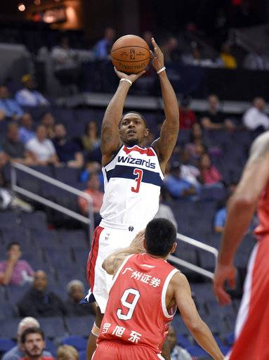 Washington Wizards guard Bradley Beal (3) shoots over Guangzhou Long-Lions' Luo Xudong (9) during the first half of an NBA basketball exhibition game, Monday, Oct. 2, 2017, in Washington.