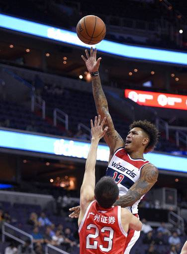 Washington Wizards forward Kelly Oubre Jr. (12) shoots against Guangzhou Long-Lions' Zhang Fan (23) during the first half of an NBA basketball exhibition game, Monday, Oct. 2, 2017, in Washington.
