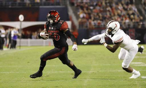 San Diego State running back Rashaad Penny runs past Northern Illinois cornerback Jalen Embry during the second half of an NCAA college football game Saturday, Sept. 30, 2017, in San Diego.
