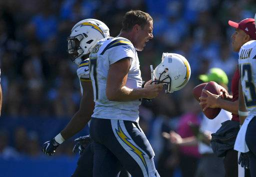 Los Angeles Chargers quarterback Philip Rivers reacts as he comes off the field during the second half of an NFL football game against the Philadelphia Eagles, Sunday, Oct. 1, 2017, in Carson, Calif.