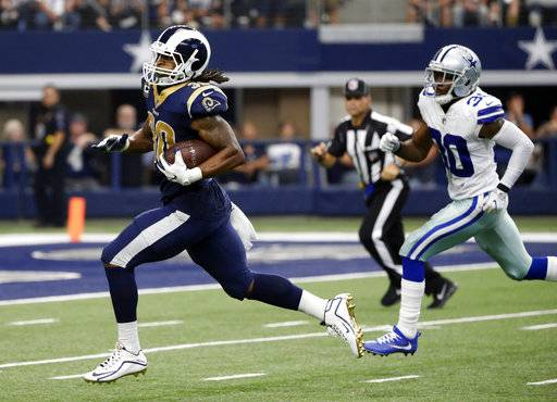 Los Angeles Rams running back Todd Gurley (30) sprints to the end zone past Dallas Cowboys cornerback Anthony Brown, right, for a touchdown in the second half of an NFL football game, Sunday, Oct. 1, 2017, in Arlington, Texas.