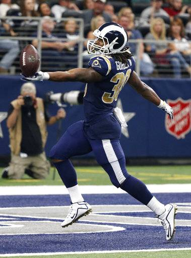 Los Angeles Rams running back Todd Gurley (30) celebrates reaching the end zone for a touchdown in the second half of an NFL football game against the Dallas Cowboys on Sunday, Oct. 1, 2017, in Arlington, Texas.