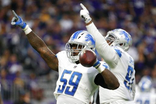 Detroit Lions middle linebacker Tahir Whitehead (59) celebrates after recovering a fumble by Minnesota Vikings running back Dalvin Cook during the second half of an NFL football game, Sunday, Oct. 1, 2017, in Minneapolis.