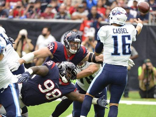Tennessee Titans quarterback Matt Cassel (16) is pressured by Houston Texans nose tackle D.J. Reader (98) and Houston Texans defensive end J.J. Watt (99) during the second half of an NFL football game Sunday, Oct. 1, 2017, in Houston.