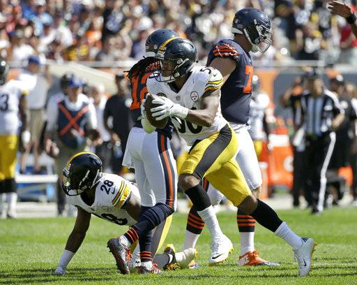 FILE - In this Sept. 24, 2017, file photo, Pittsburgh Steelers linebacker Ryan Shazier (50) celebrates after recovering a fumble by Chicago Bears running back Jordan Howard during the second half of an NFL football game in Chicago. In the span of four quarters against the Baltimore Ravens on Sunday, Oct. 1, Shazier put all of his remarkable tools on display, the ones his teammates see on a daily basis, the ones that have been far too infrequent for Shazier's liking during his first three seasons.