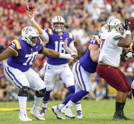 LSU quarterback Danny Etling (16) throws against Troy in the first half of an NCAA college football game in Baton Rouge, La., Saturday, Sept. 30, 2017.