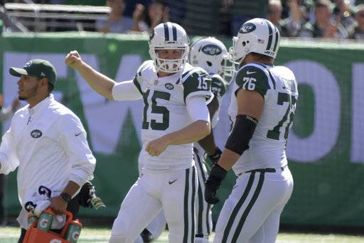 New York Jets quarterback Josh McCown (15), center, reacts after teammate Bilal Powell scored a touchdown during the first half of an NFL football game against the Jacksonville Jaguars, Sunday, Oct. 1, 2017, in East Rutherford, N.J.