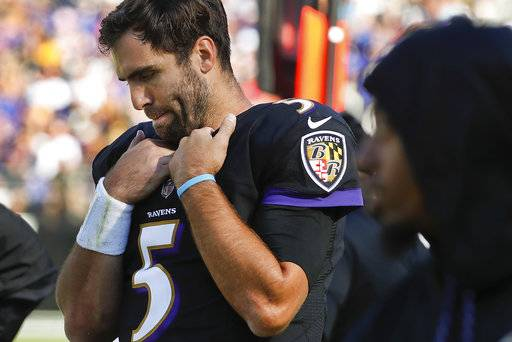 Baltimore Ravens quarterback Joe Flacco (5) walks along the sidelines during the second half of an NFL football game against the Pittsburgh Steelers in Baltimore, Sunday, Oct. 1, 2017. The Steelers defeated the Ravens 26-9.