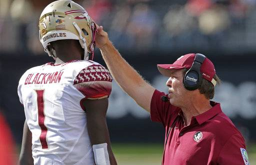 Florida State head coach Jimbo Fisher, right, talks with James Blackman (1) in the first half of an NCAA college football gamea gainst Wake Forest in Winston-Salem, N.C., Saturday, Sept. 30, 2017.
