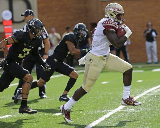 Florida State's Jacques Patrick (9) runs past Wake Forest's Jessie Bates III (3) in the first half of an NCAA college football game in Winston-Salem, N.C., Saturday, Sept. 30, 2017.
