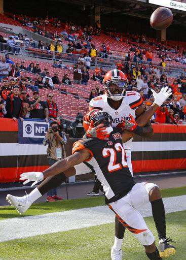Cincinnati Bengals cornerback William Jackson (22) breaks top a pass intended for Cleveland Browns wide receiver Kenny Britt (18) in the second half of an NFL football game, Sunday, Oct. 1, 2017, in Cleveland.