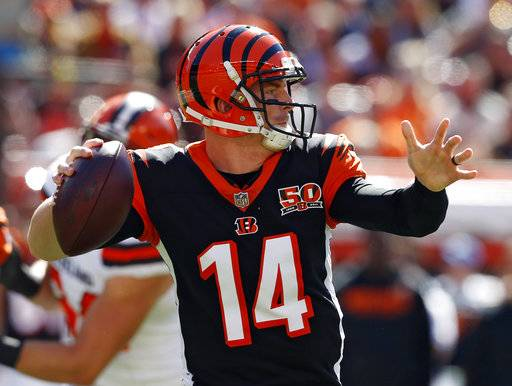 Cincinnati Bengals quarterback Andy Dalton looks to throw in the first half of an NFL football game against the Cleveland Browns, Sunday, Oct. 1, 2017, in Cleveland.