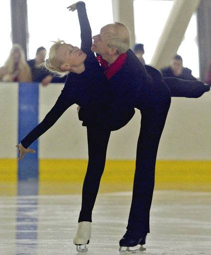 FILE In this file photo taken on Saturday, March 1, 2003, First Soviet Olympic figure skating champions Ludmila Belousova and Oleg Protopopov skate at the Yubileyny arena, where they started to skate together in 1948, in St.Petersburg, Russia. Russian news reports say Ludmila Belousova, a two-time Olympic champion in pairs figure skating, has died. She was 81, it was reported on Friday, Sept. 29, 2017.