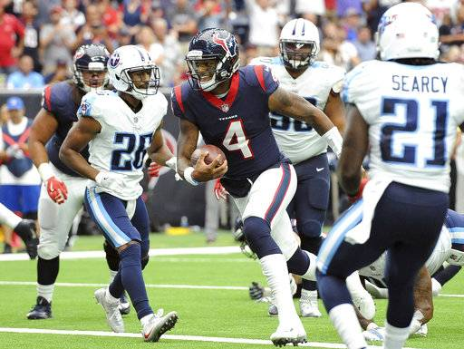 Houston Texans quarterback Deshaun Watson (4) runs for a touchdown against the Tennessee Titans during the first half of an NFL football game, Sunday, Oct. 1, 2017, in Houston.