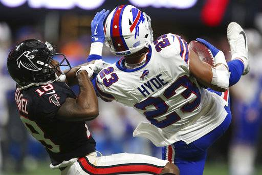 Buffalo Bills strong safety Micah Hyde (23) intercepts a pass intended for Atlanta Falcons wide receiver Taylor Gabriel (18) during the second half of an NFL football game, Sunday, Oct. 1, 2017, in Atlanta.