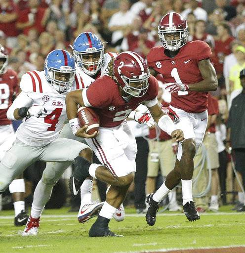 Alabama quarterback Jalen Hurts runs the ball in to score a touchdown during the first half of an NCAA college football game against Mississippi, Saturday, Sept. 30, 2017, in Tuscaloosa, Ala.