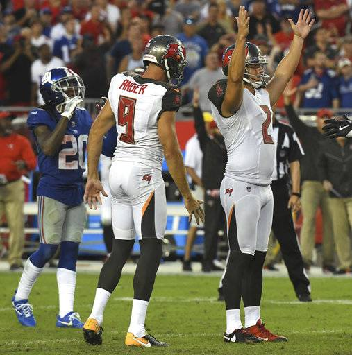 Tampa Bay Buccaneers kicker Nick Folk (2) celebrates his game-winining field goal as time expires with punter Bryan Anger (9) during an NFL football game Sunday, Oct. 1, 2017, in Tampa, Fla.