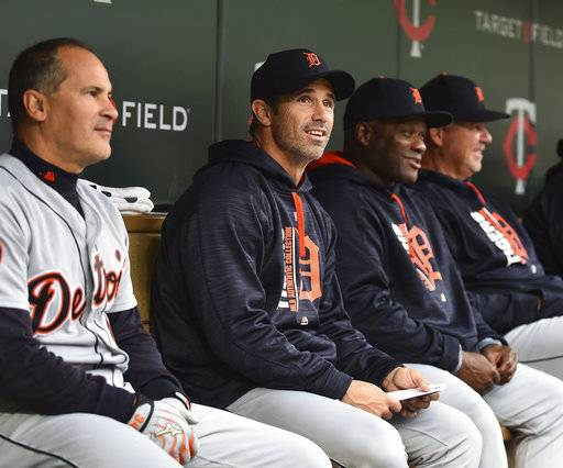 Detroit Tigers manager Brad Ausmus, second from left, sits with his coaches in the dugout as they play the Minnesota Twins in the eighth inning of a baseball game, Sunday, Oct. 1, 2017, in Minneapolis.